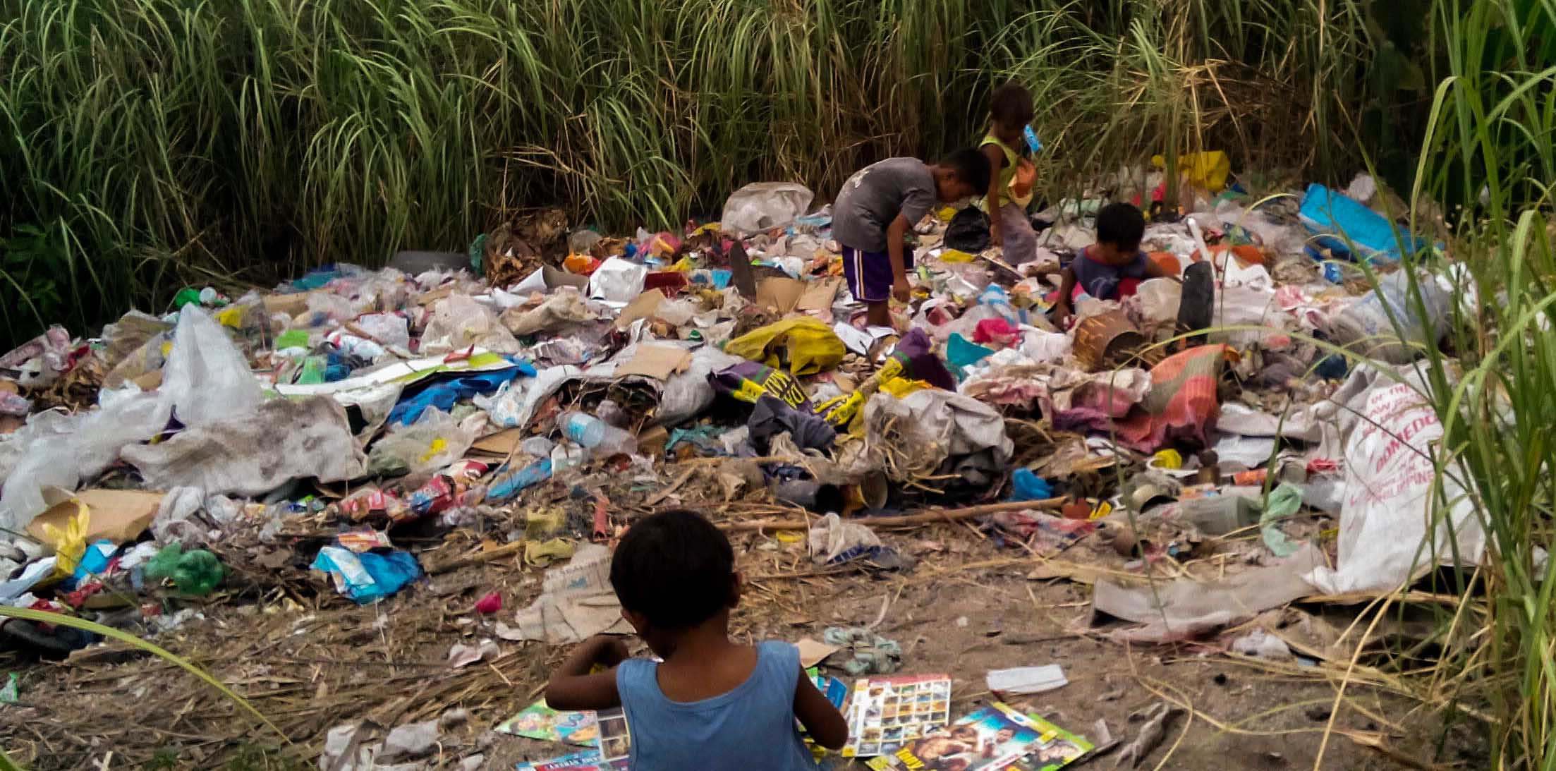 Kids playing on the trash