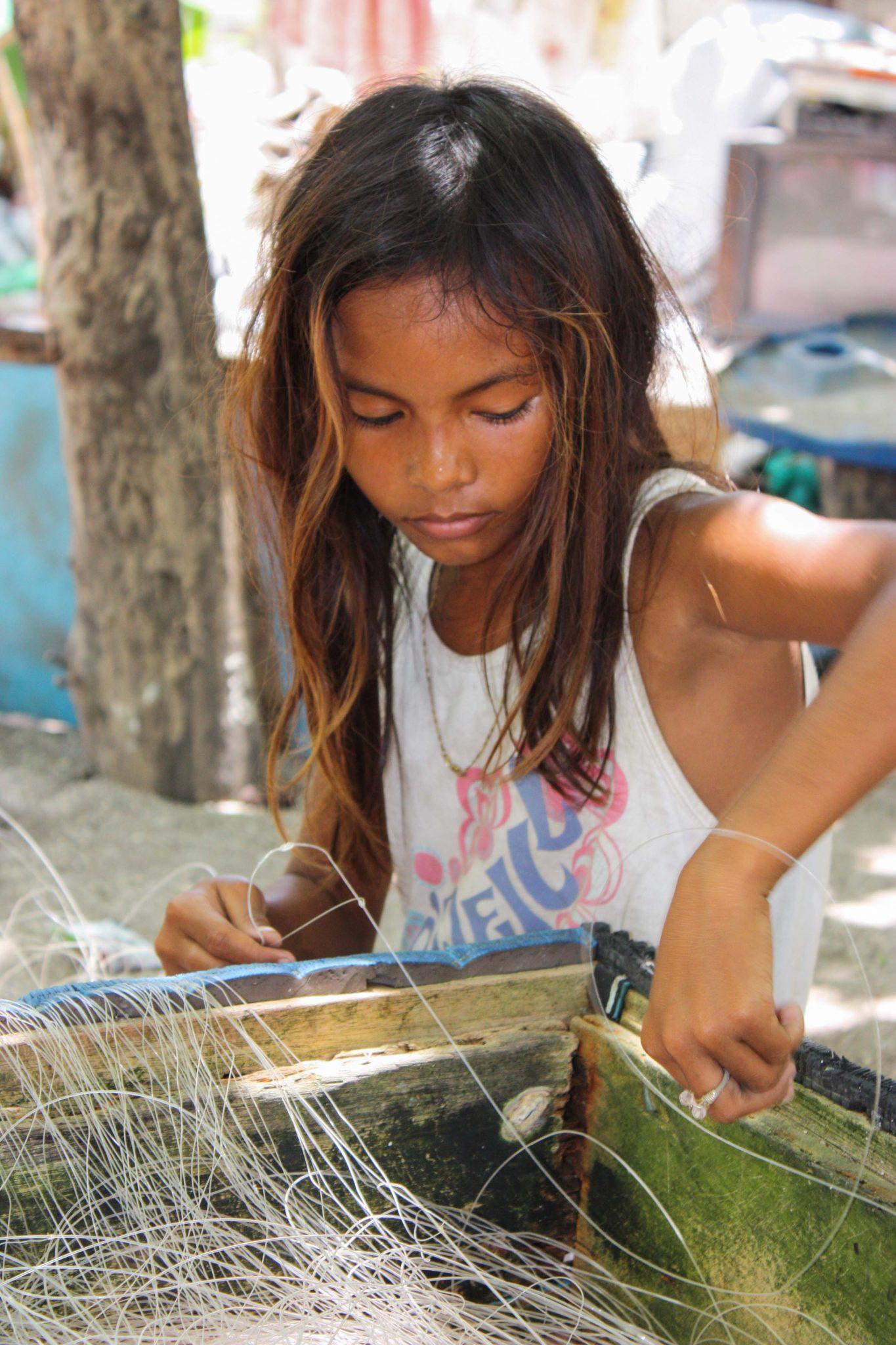 kid preparing fishing line