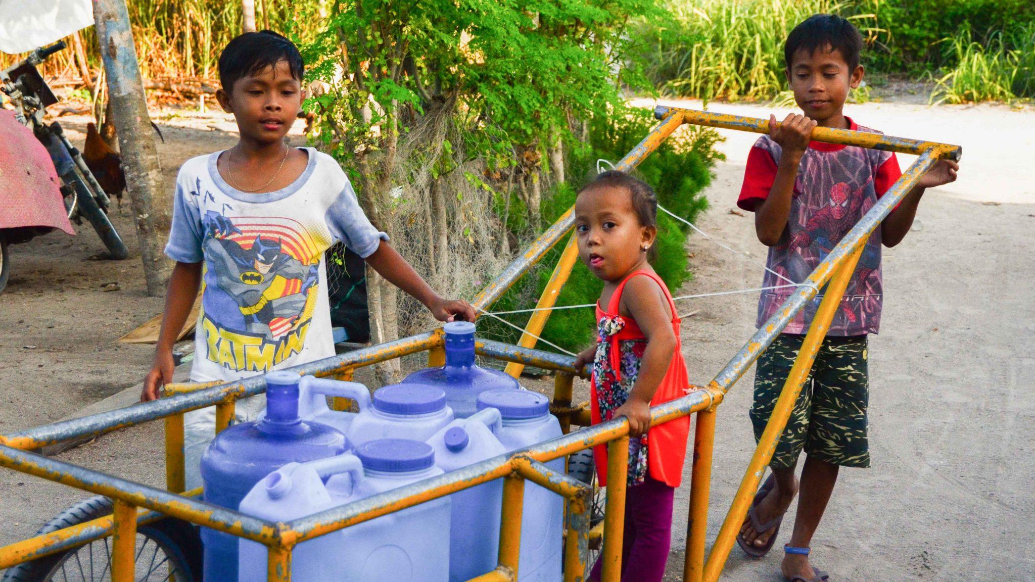 kids bringing water